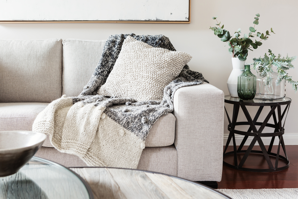 8. Rugs + Cushions - Place rugs over floorboards and use textured cushions and throws on furniture.
