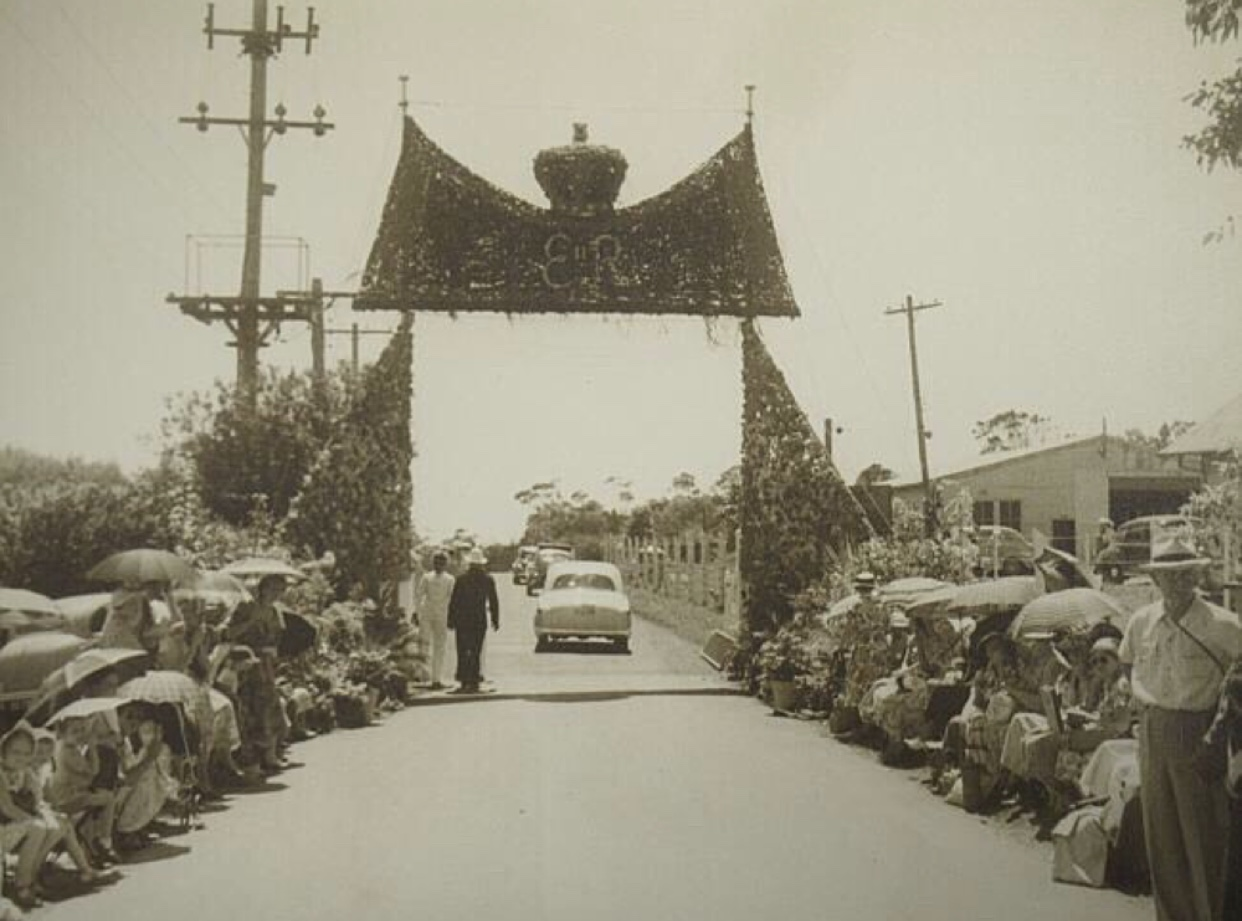 A huge floral arch was created for The Queen during her visit to Mosman in 1954.