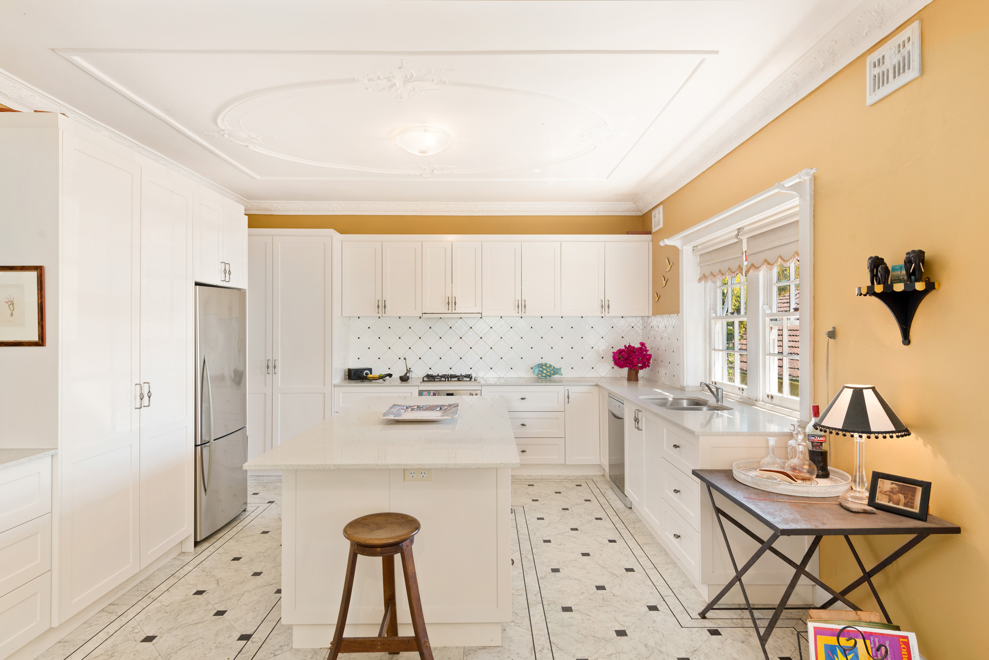 This gourmet kitchen features the home's original ornate ceiling, circa 1919.
