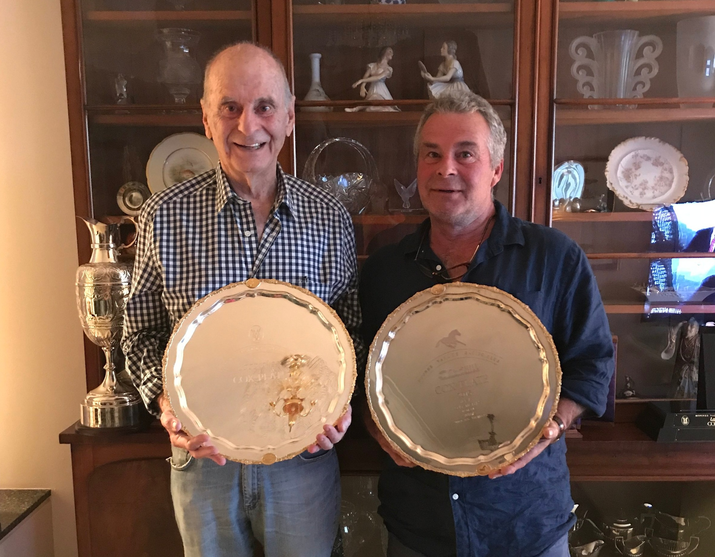 Mosman's Richard Treweeke with son Rick and two of the four Cox Plates won by Winx.