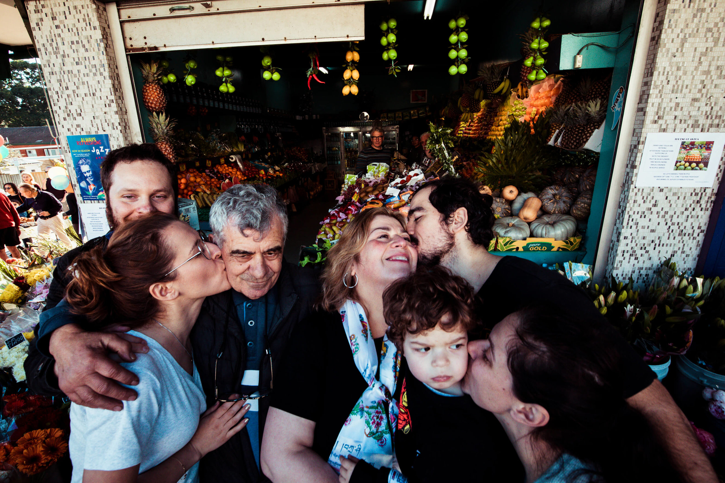 Alexandra Pipertzis and Dennis Koustoubardis   kiss their parents at Jimmy and Toula's retirement party on Avenue Rd.