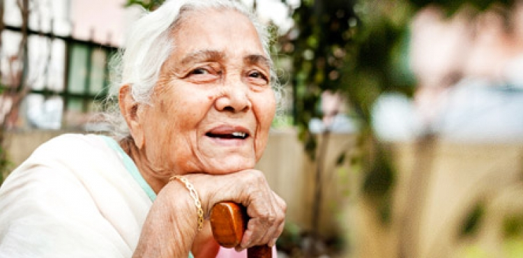 older-indian-woman-with-cane_0.jpg