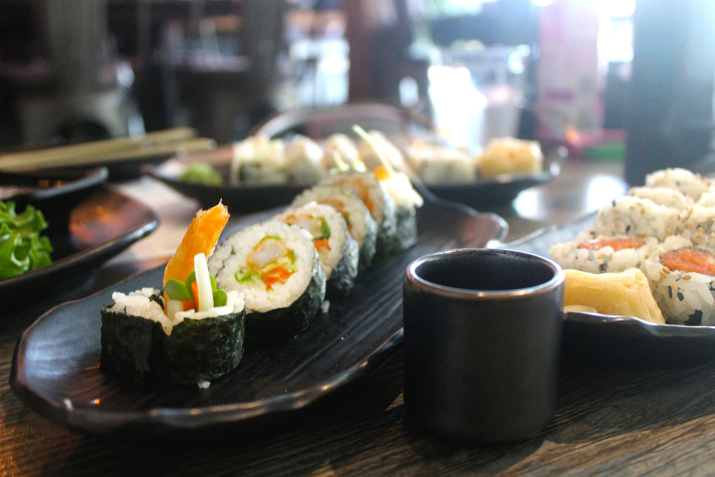 Food & Drink - Enjoy delicious rolls, craft cocktails, sake and more.