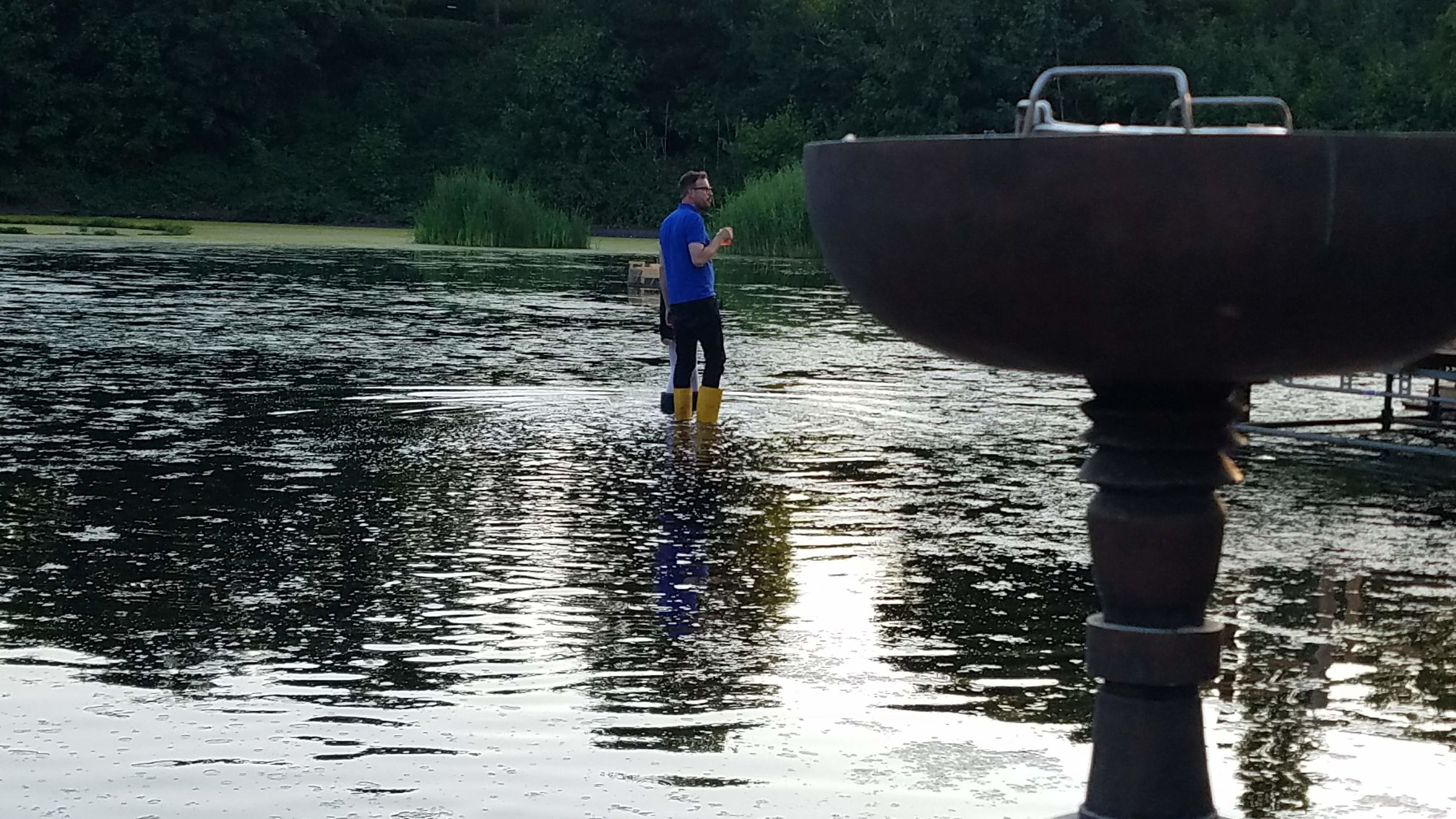 Markus Bader, out for a walk. The water around the Floating University is very shallow - after some rain, maybe six inches. Whenever it is time to have a conversation, you can simply pull on a pair of fishing boots, and start doing laps around the reservoir.