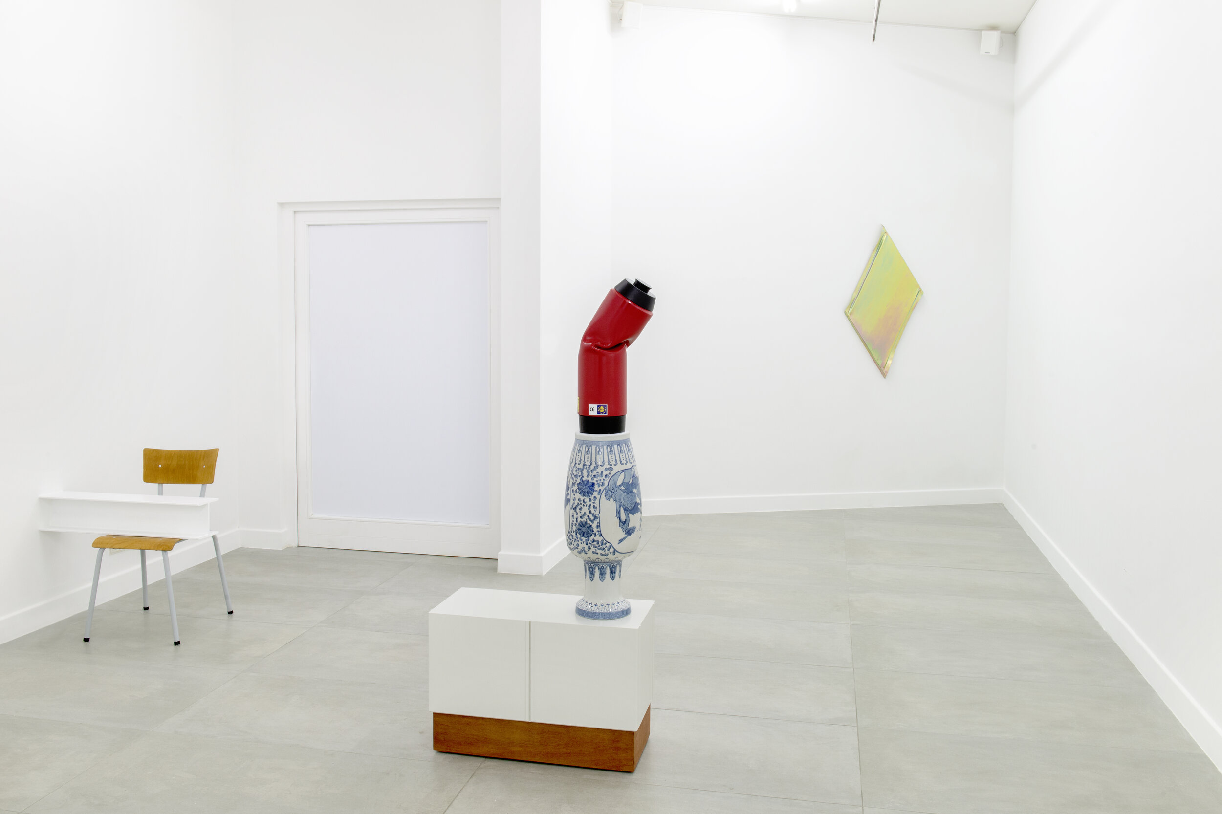 Exhibition view duo show 'allo, 'allo. (l-r) (1) Roeland Tweelinckx -  Replacements  (2019), white beam, chair 80 x 50 x 78 cm | (2) Roeland Tweelinckx -  How Soon Is Now  (2018) synthetic material, wood, ceramics and paint, 160 x 70 x 30 cm | (3) Just Quist-  Untitled (so you are friends with camels) (2014)  pacified steel, 114 x 61 cm. Barbé Urbain gallery , Gent, BE.