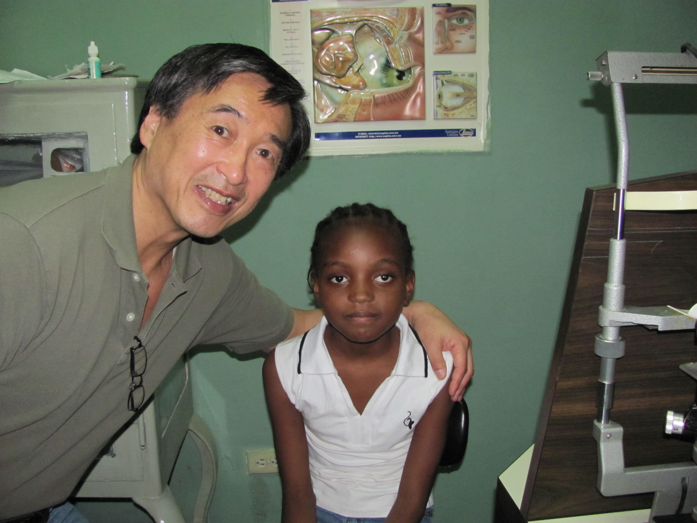 Dr. Soong with a patient in Haiti