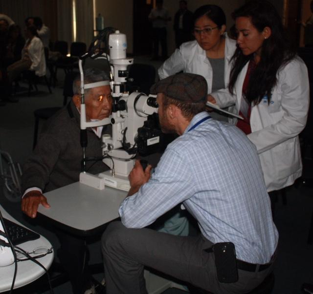 Dr. Kresch at the slit lamp in Trujillo, Peru