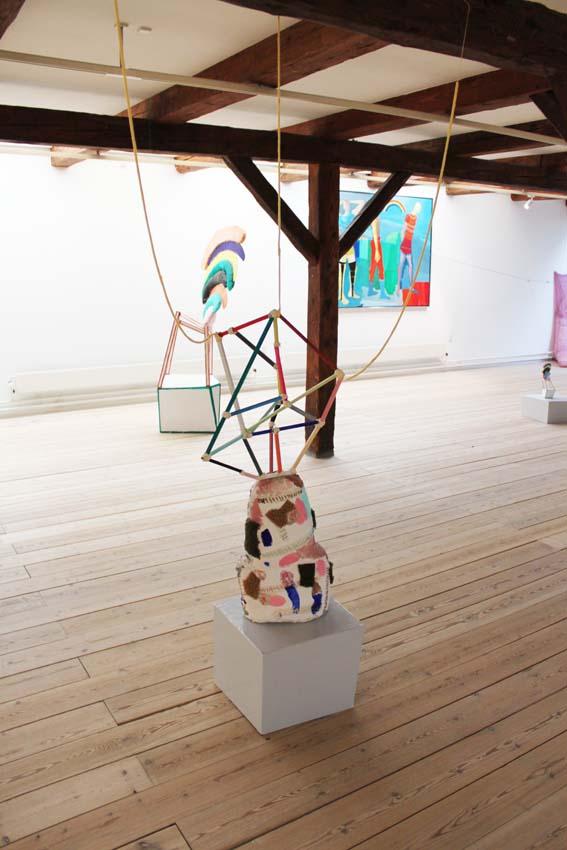 """I am grateful"" 156 x 60 x 45 cm. Stuffed canvas object, oil paint, acrylic paint, woodsticks,yarn, textiles. woodpidestal. 2014.""Ping-pong"".  PAKHUSgalleriet. 2014 Nykøbing Sj.Denmark"