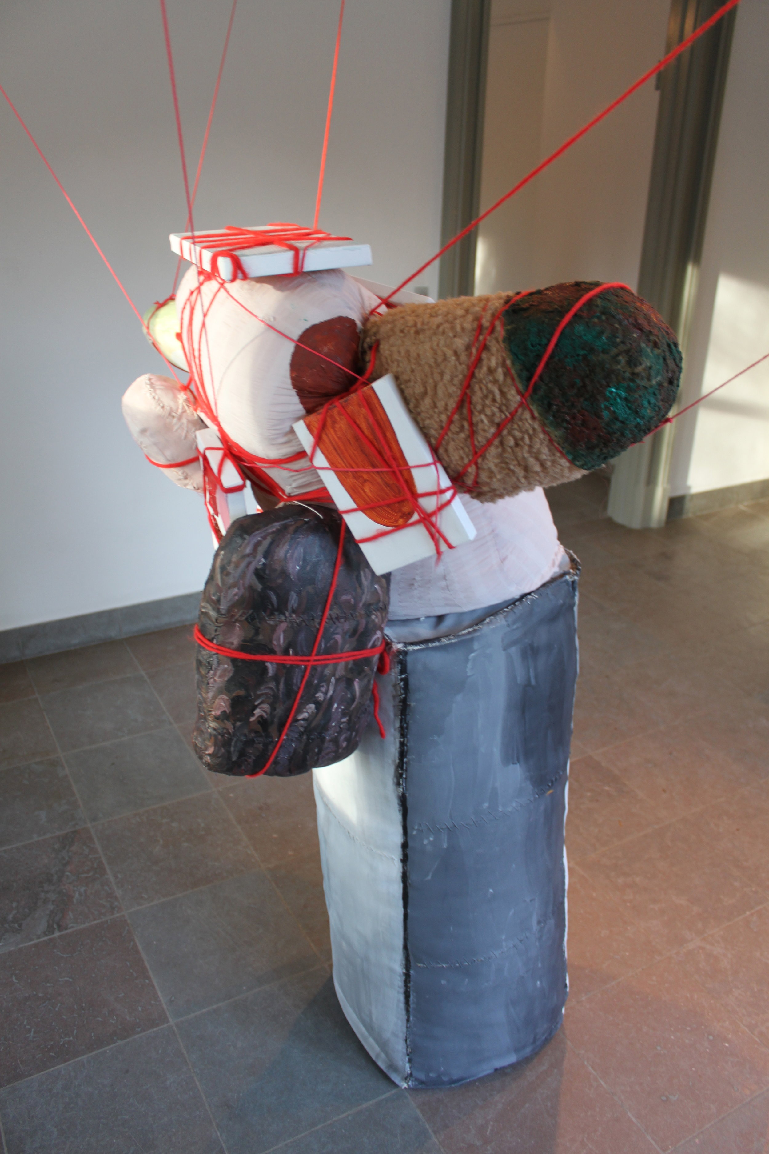 """Powerless""  1.41 x 0.89 x 0.75 meter. Acrylic on textile objects, stuffed textile objects, acrylic on canvas, yarn, engine.The sculpture is moved via drag on strings,it seems as if the whole sculpture breathing. Playgrounds. Møstings Hus 2011."
