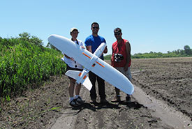 NCC staff with Mauricio Ortiz during a drone flight training session (Photo by NCC)