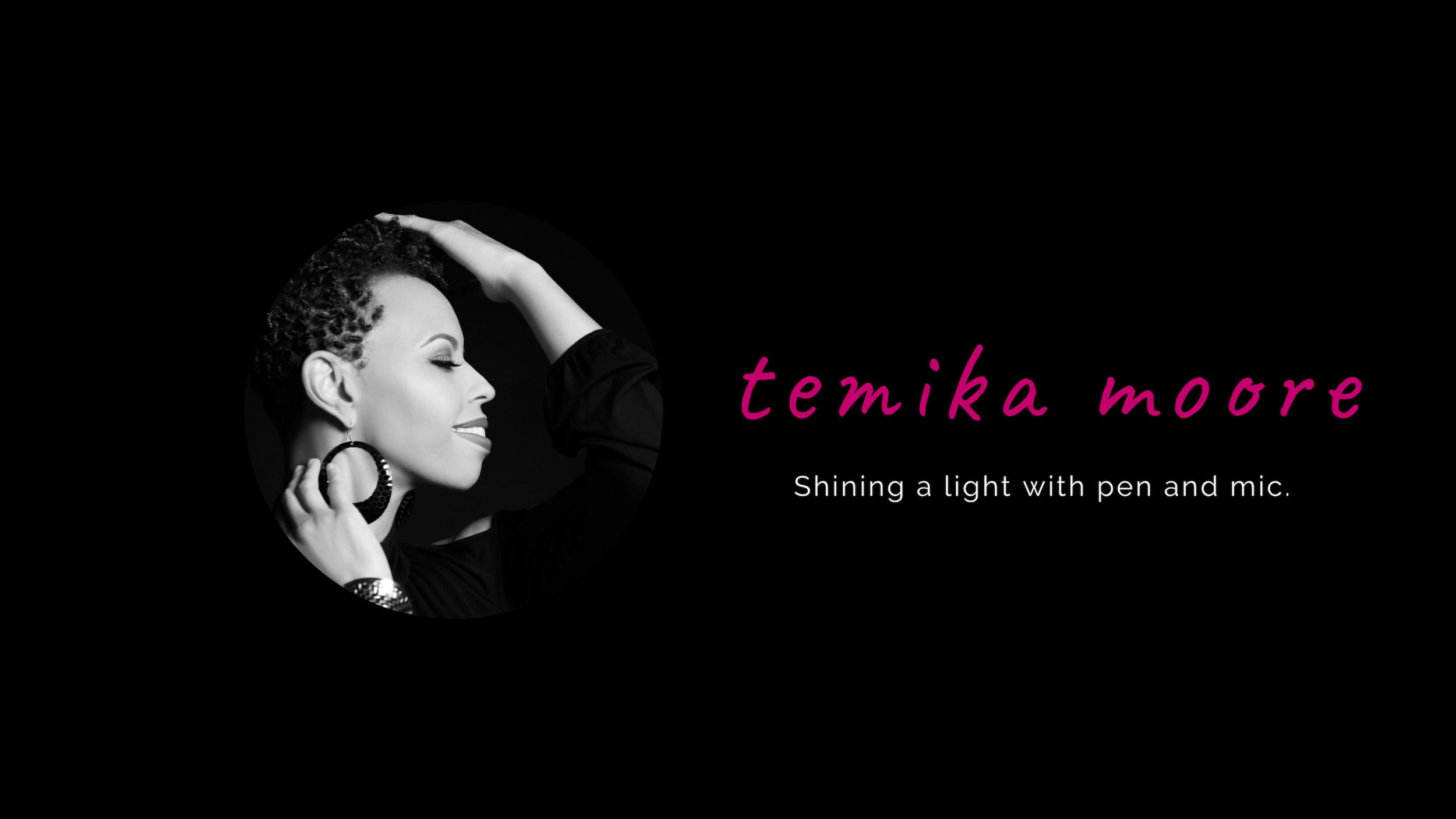 temika-moore-shining-a-light-with-pen-and-mic.png