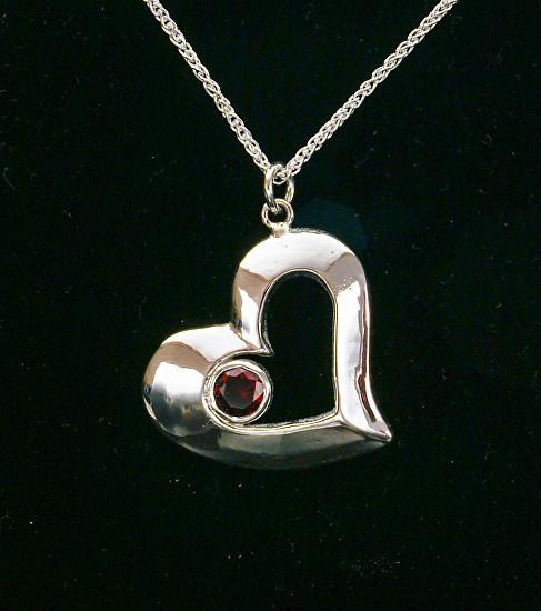 Ruby Set in Silver Heart
