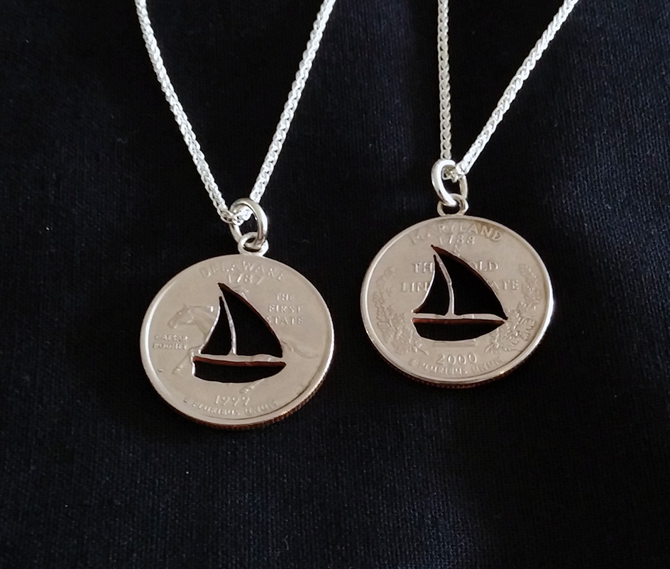 Sail Boat carved into a Quarter