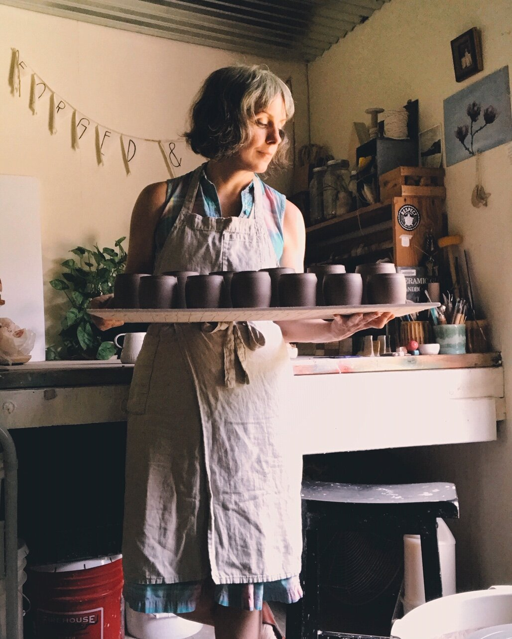 A day in the studio making tealight holders, wearing a vinatge 1980's Bermuda plaid shirt dress covered in a handmade potter's apron by  Portland Apron Company .