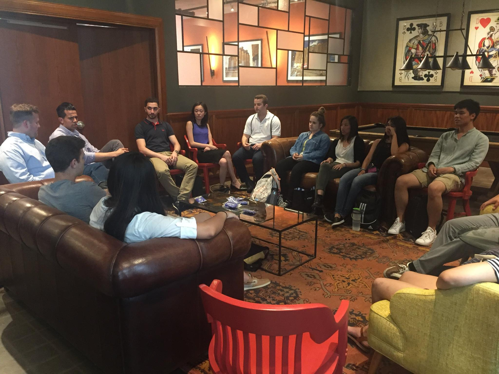 Mohammad and his fellow Chicago fellows talking startup strategy during orientation.