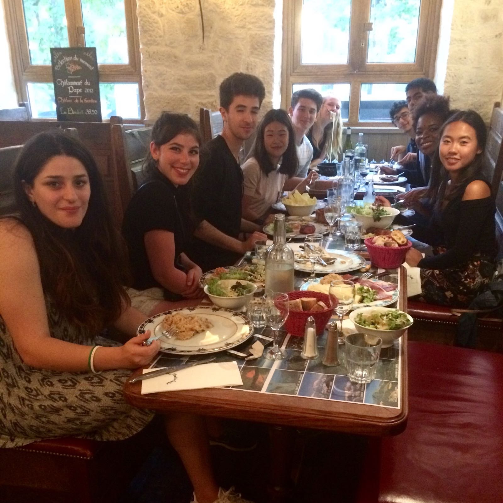 Nicolas and other Sage Corps Paris fellows enjoying an authentic French dinner.