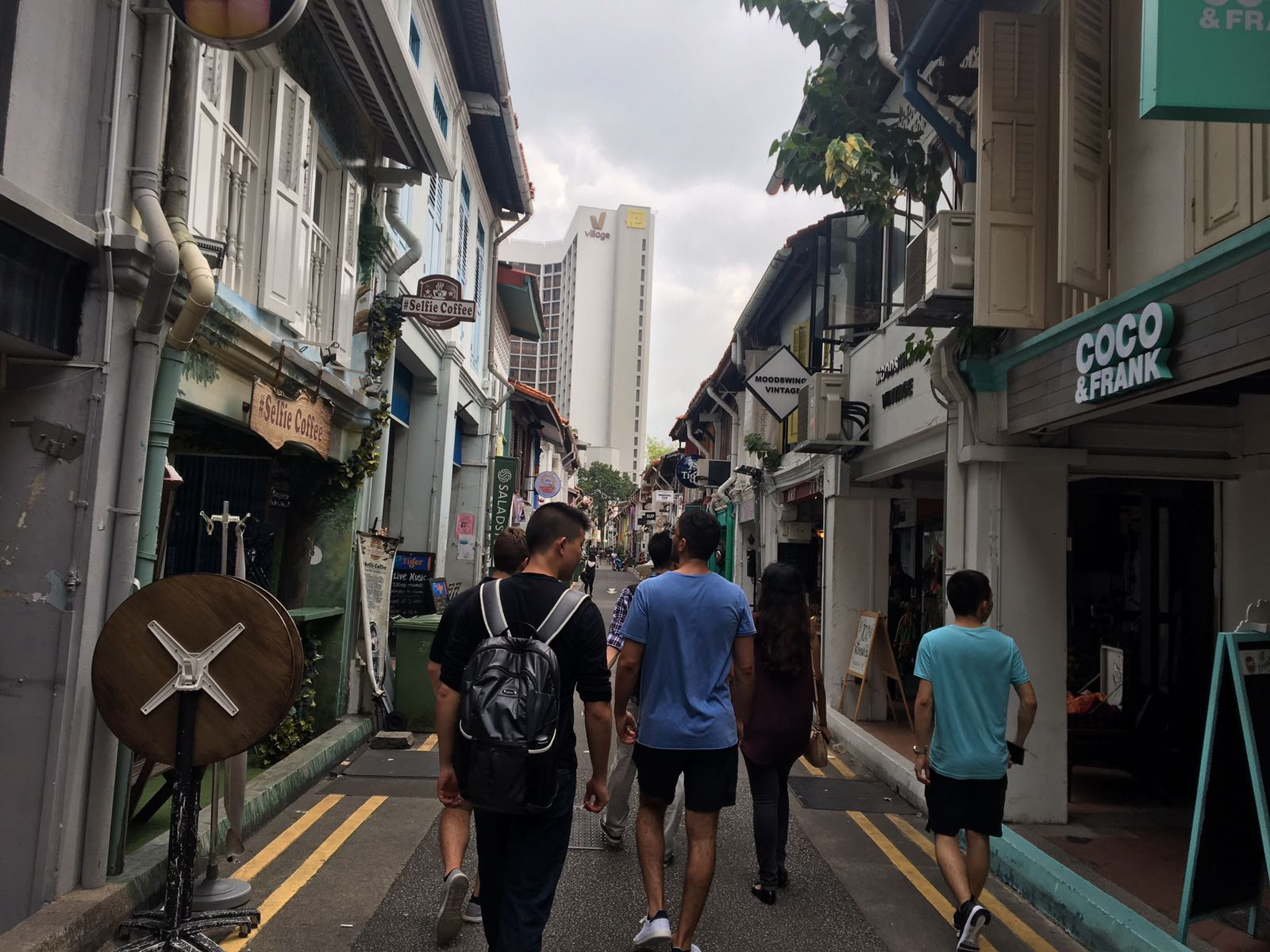 Tommy and his cohort exploring the streets of Singapore.