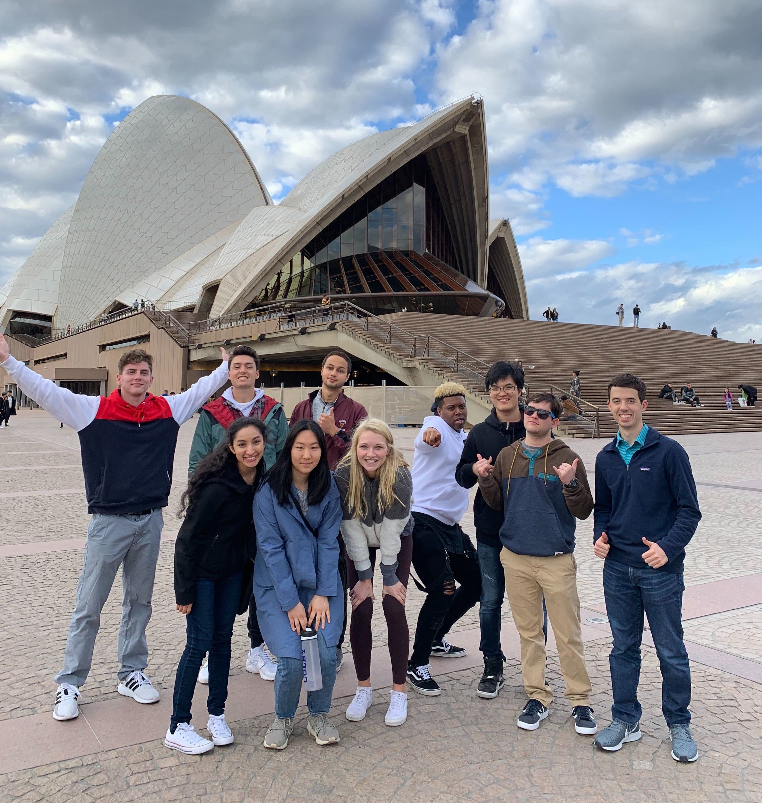 Samina poses in front of the iconic Sydney Opera House with the rest of the 2019 Sage Corps Sydney Summer Cohort.