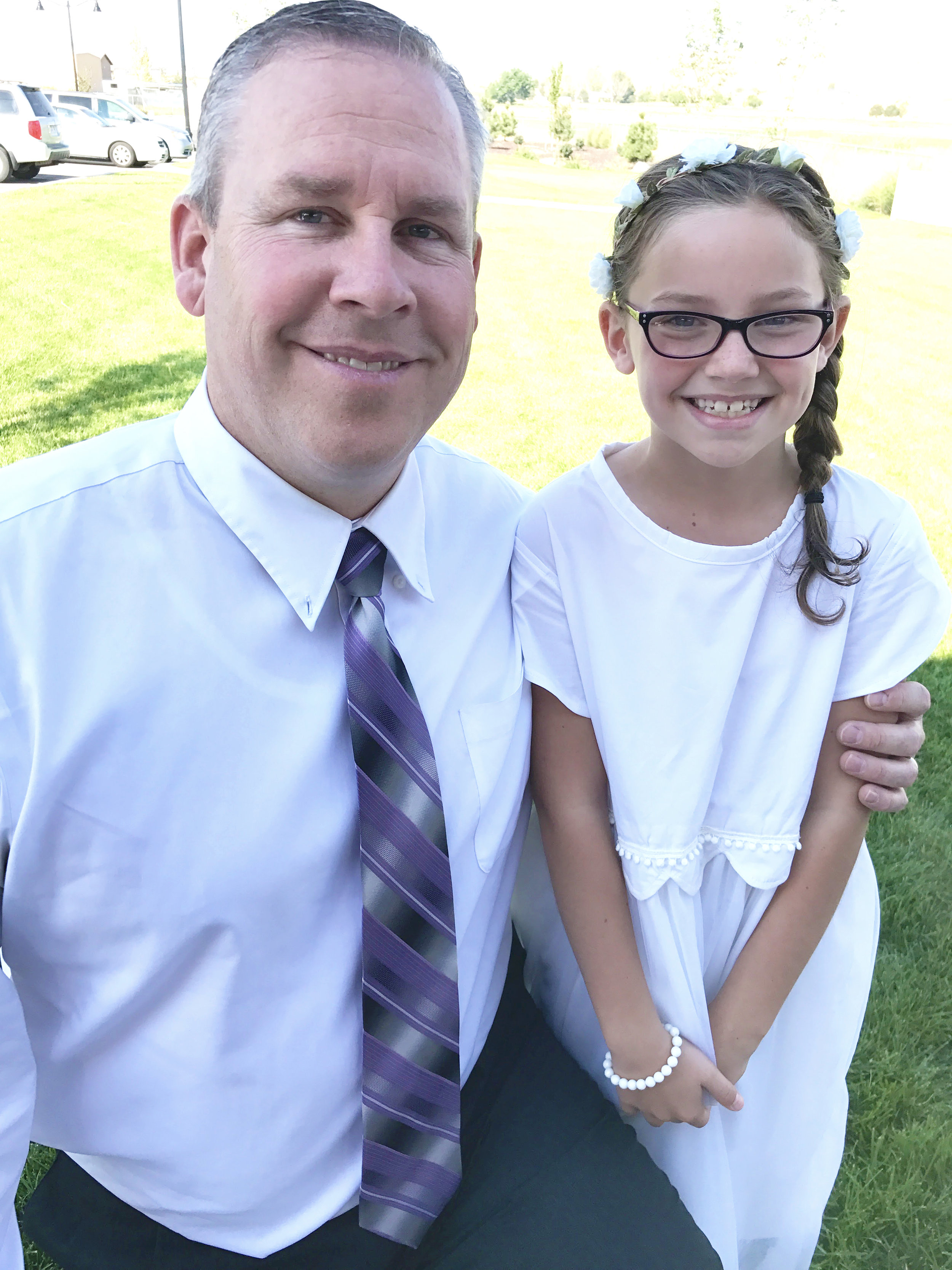 Daughter wearing her dad's dress shirt Refashioned into a baptism dress.