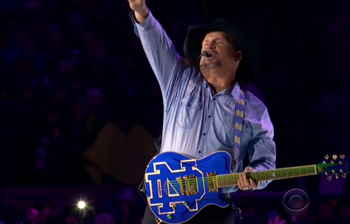 The legendary Garth Brooks using our Notre Dame Guitar Strap / Live at Notre Dame Stadium, December 2018