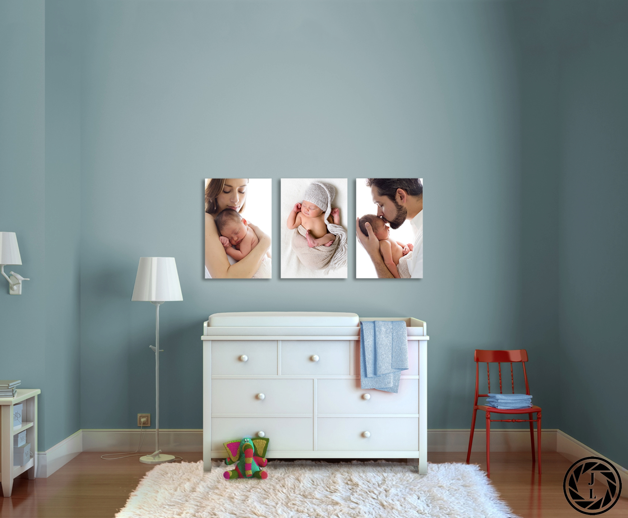 nursery set up with family portraits on the wall