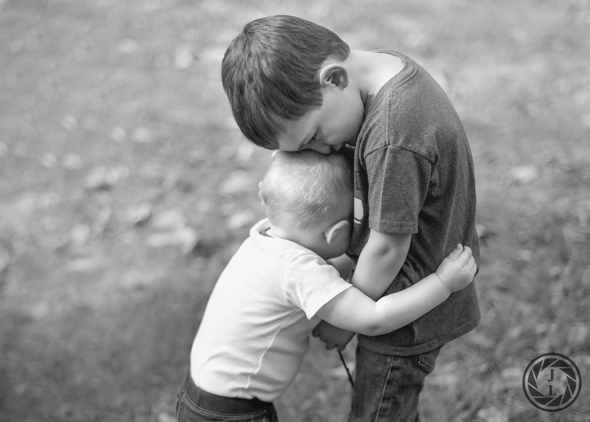 Two brother hugging in a sweet moment while playing in Central Park