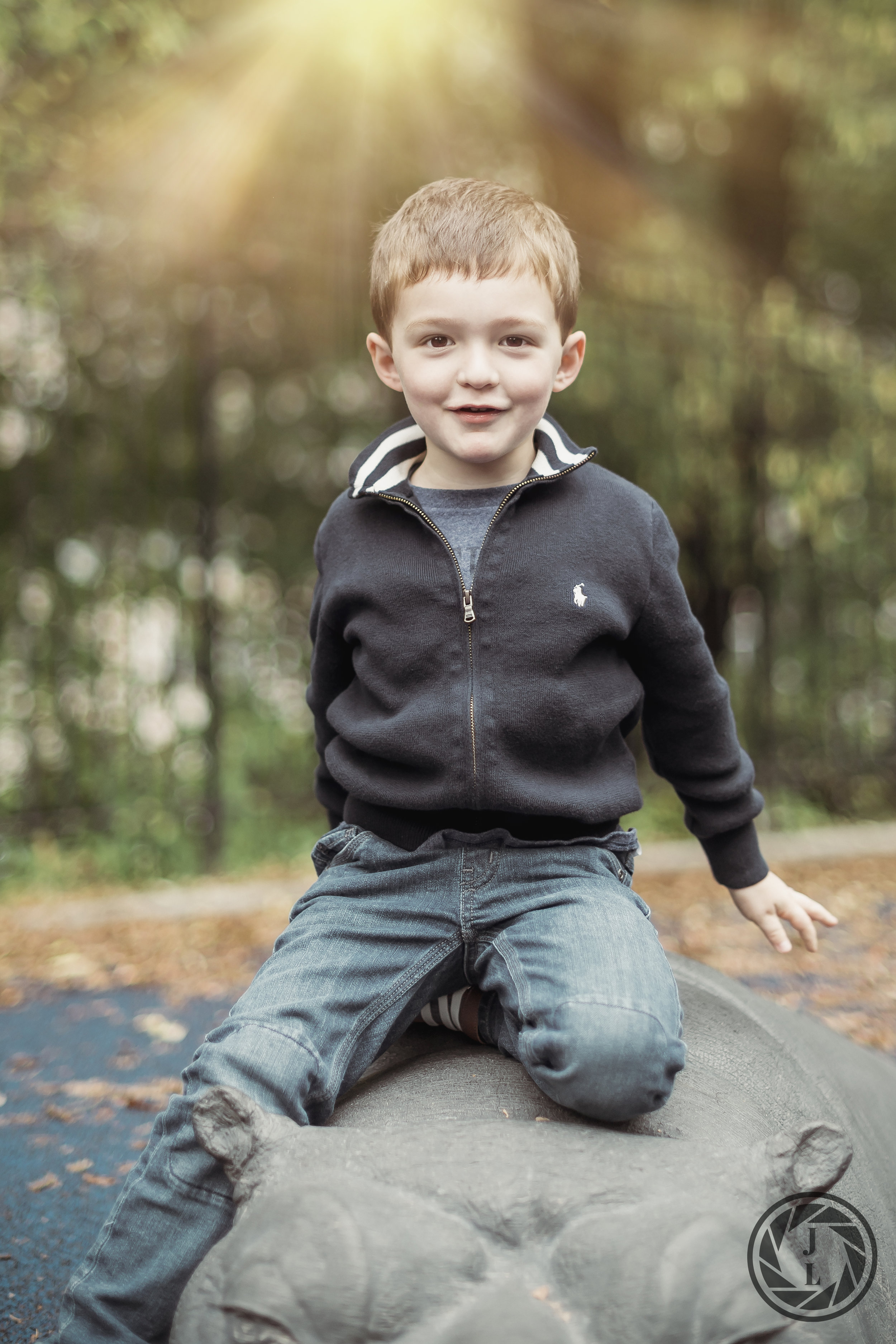 A little boy posing in beautiful light in Safari Playground in Central Park