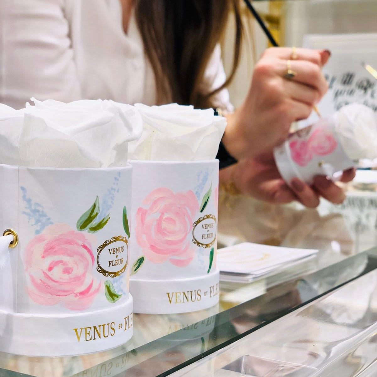 VENUS ET FLEUR - 16th May 2019 | London, MayfairLive illustration on the mini floral hat boxes, in the London floral boutique to celebrate the launch of the new bridal collection.
