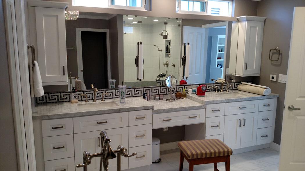 A custom vanity mirror installed above twin sinks.