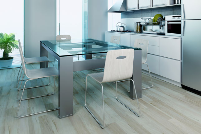 A heavy glass dining room table on a modern base.