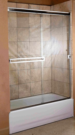 """An example of a 3/16"""" semi-frameless shower enclosure above a fiberglass tub with tiled walls."""