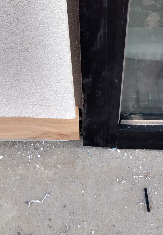 Sealant gap at bottom of storefront allowing water in the building.