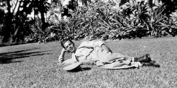 Sam Richiusa laying on the lawn near the Royal Hawaiian the day before Pearl Harbor