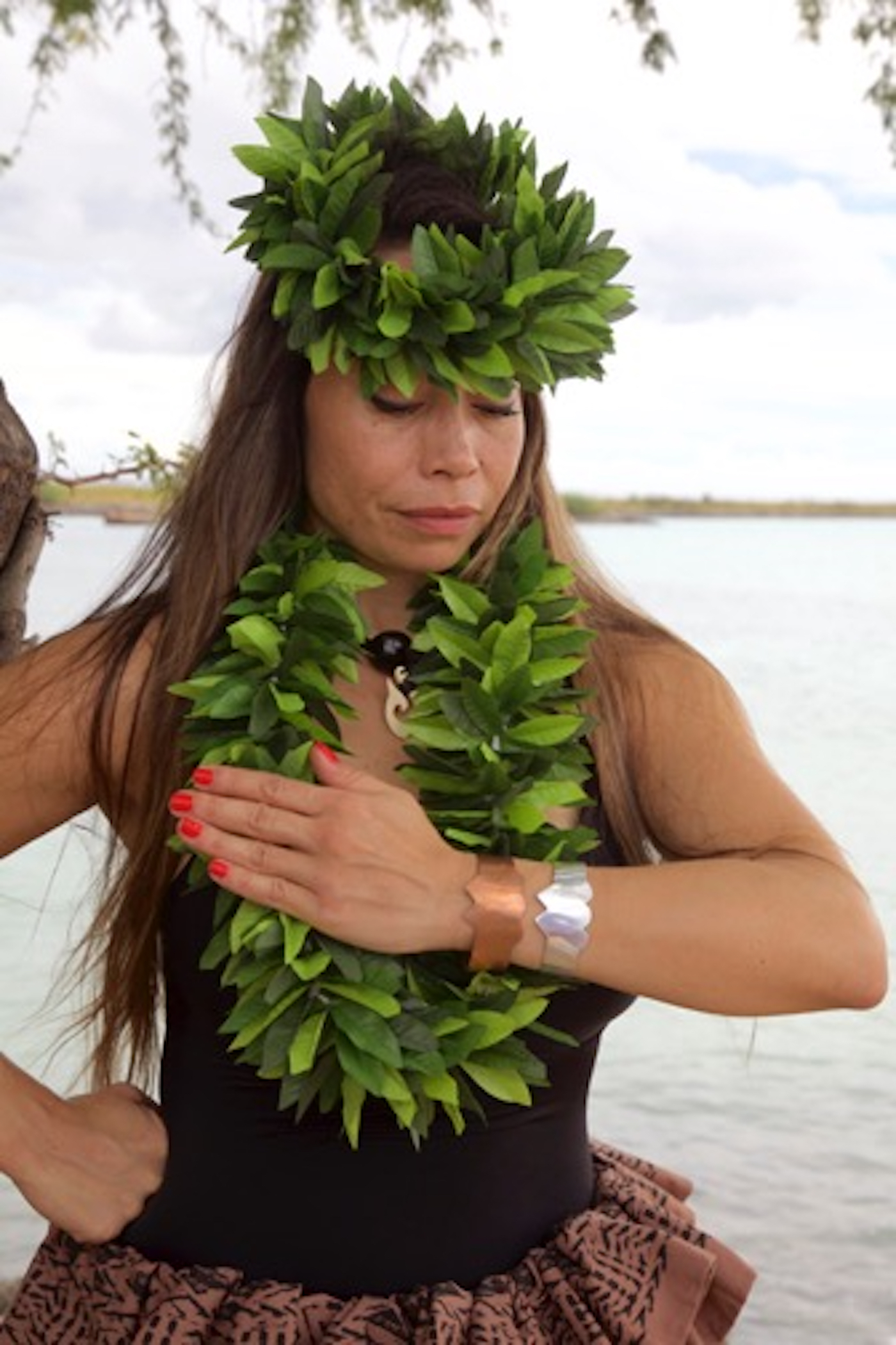 Michelle Manu at Hickam Beach wearing the original and replica Heroes' Hearts bracelets