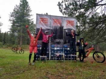 Dana Antonio (far right) enjoys a rainy podium at Revolution Enduro Buffalo Creek.