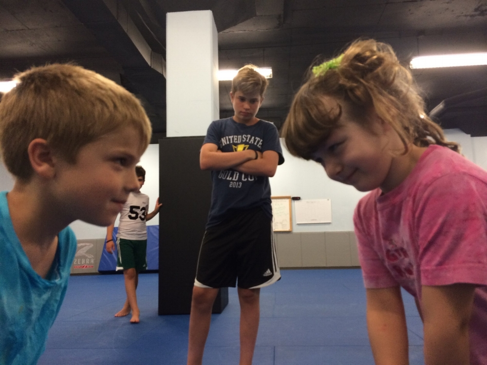 Two kids face off before a BJJ match
