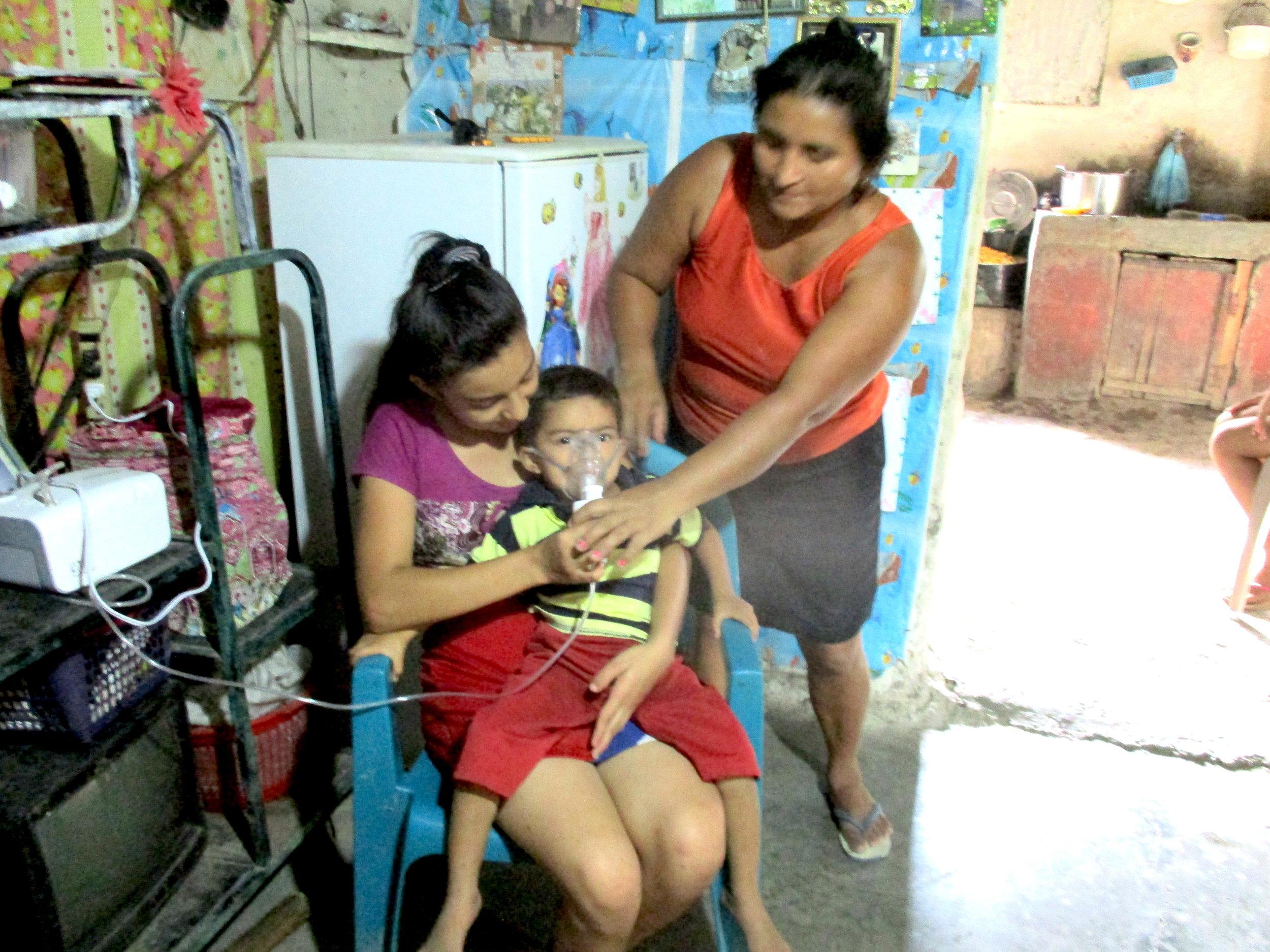 Bienvenida Aguilar, El Tule health volunteer, using a nebulizer.