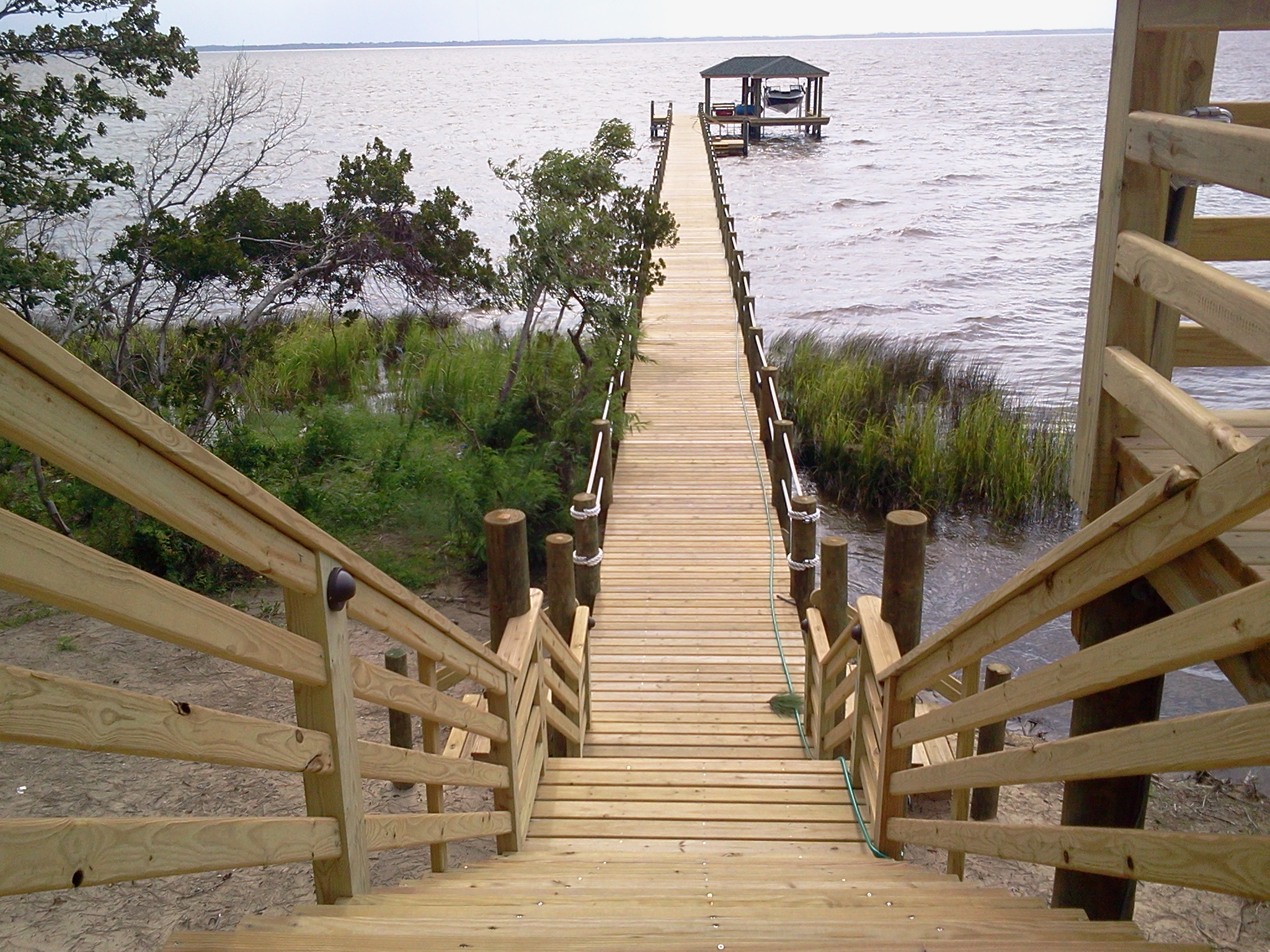 Landward Walkways and Decks  - New construction for walkways through the marsh area & home decks with walkways to the waterfront. Kayak Launch Platforms and Storage – New construction of platforms that are low enough to the allow easy access for kayaking and kayak storage.