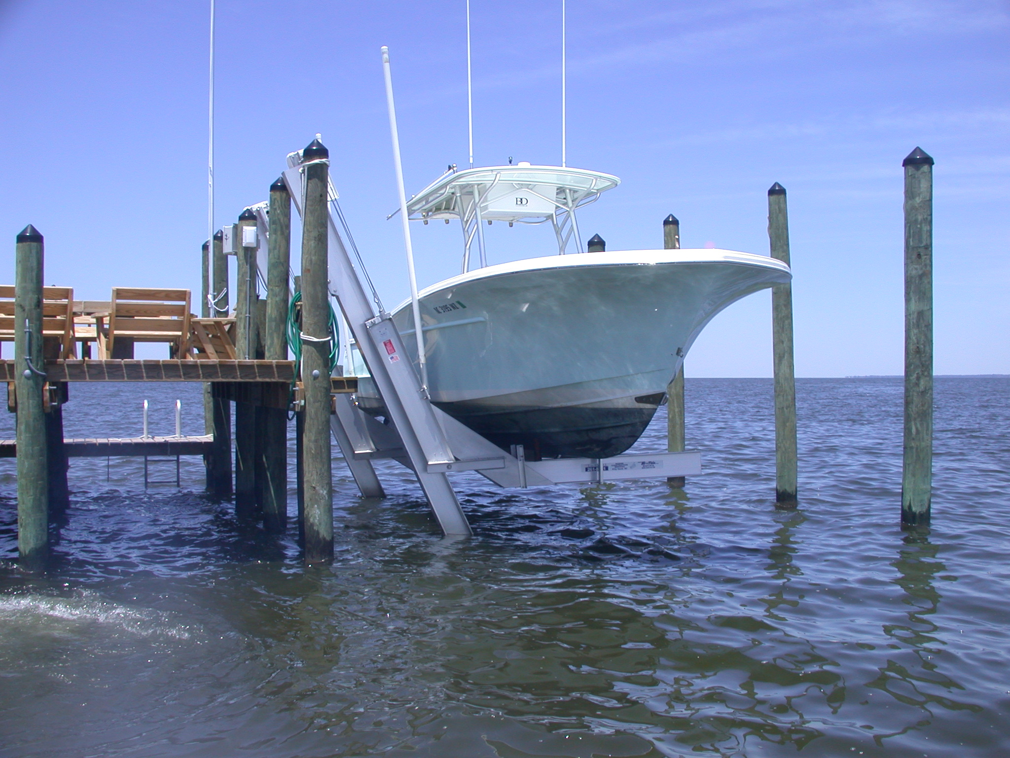 Hi-Tide Boat Lifts and PWLs - (installation, service and repair) LSI is Hi-Tide's authorized dealer of boat lifts ranging in lifting capacity from 1,000 lbs to 30,000 lbs. Hi-Tide also offers their Yacht Lifts for lifting capacity up to 90,000 tons. Hi-Tide's patented one-piece sealed gear box provides customers with a cleaner, quieter, faster, and more durable solution to lifting their boat. LSI stocks parts and provides 24-48 hour emergency repair to our Outer Banks and Currituck boat lift clients.