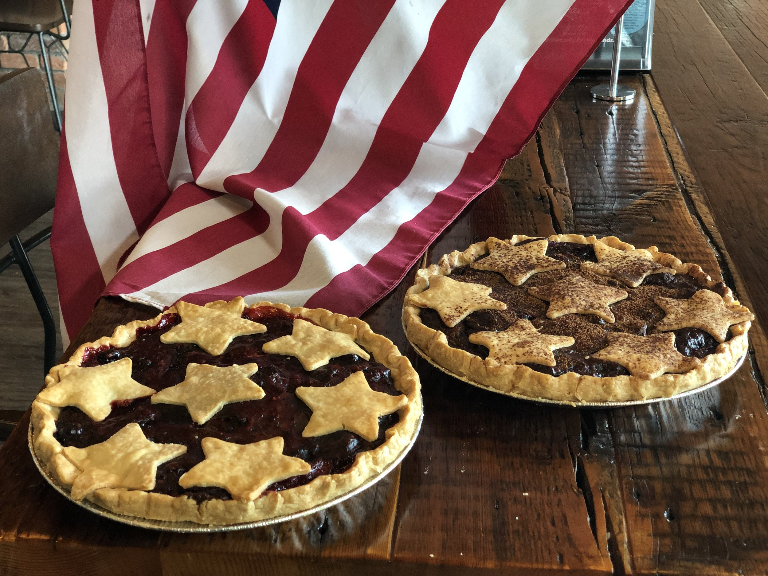 Stars and Stripes Blueberry Pie - We LOVE making every holiday special at the shop!Order your baked goods today and make your holidays special too!