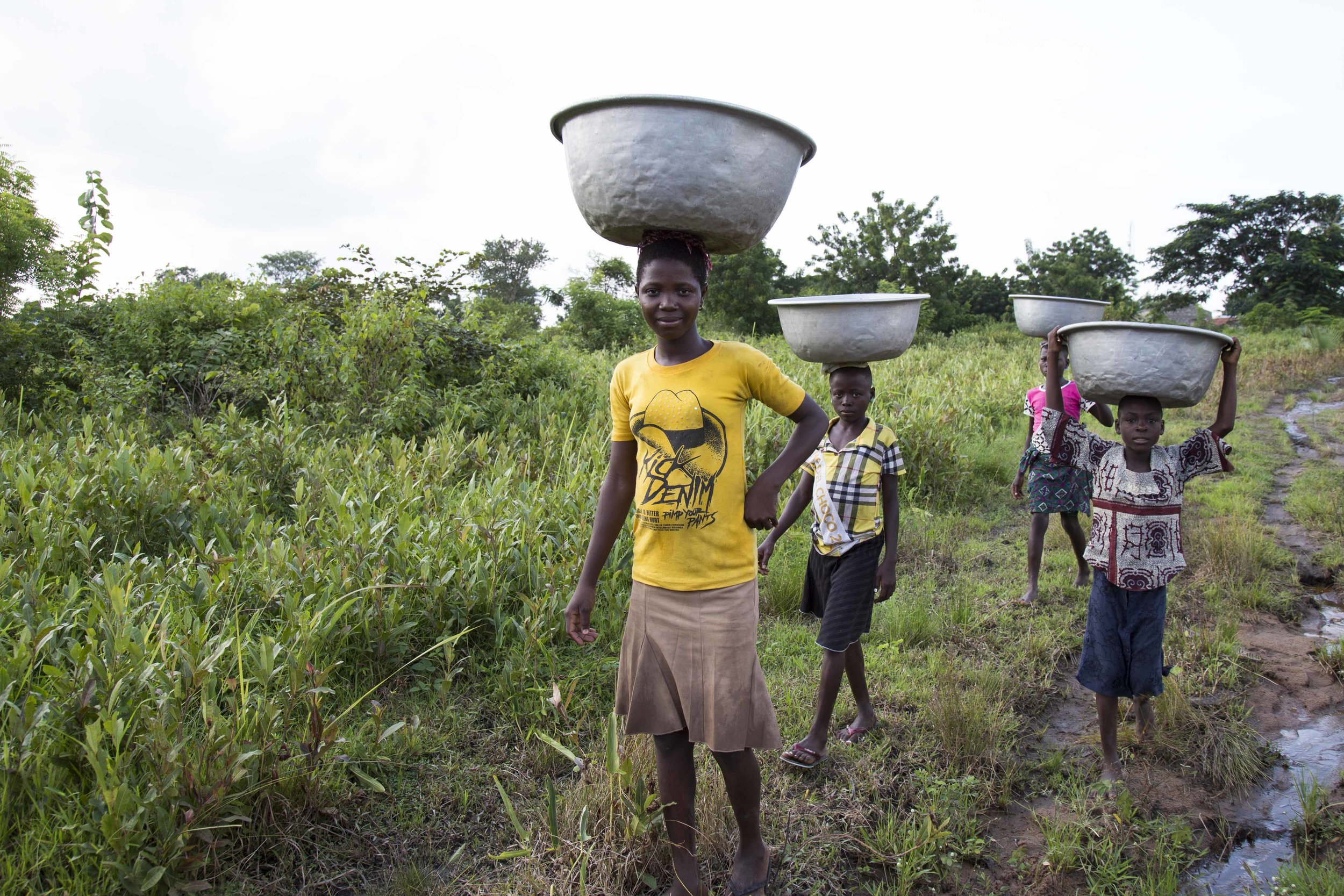 Young girls grabbing water for their family