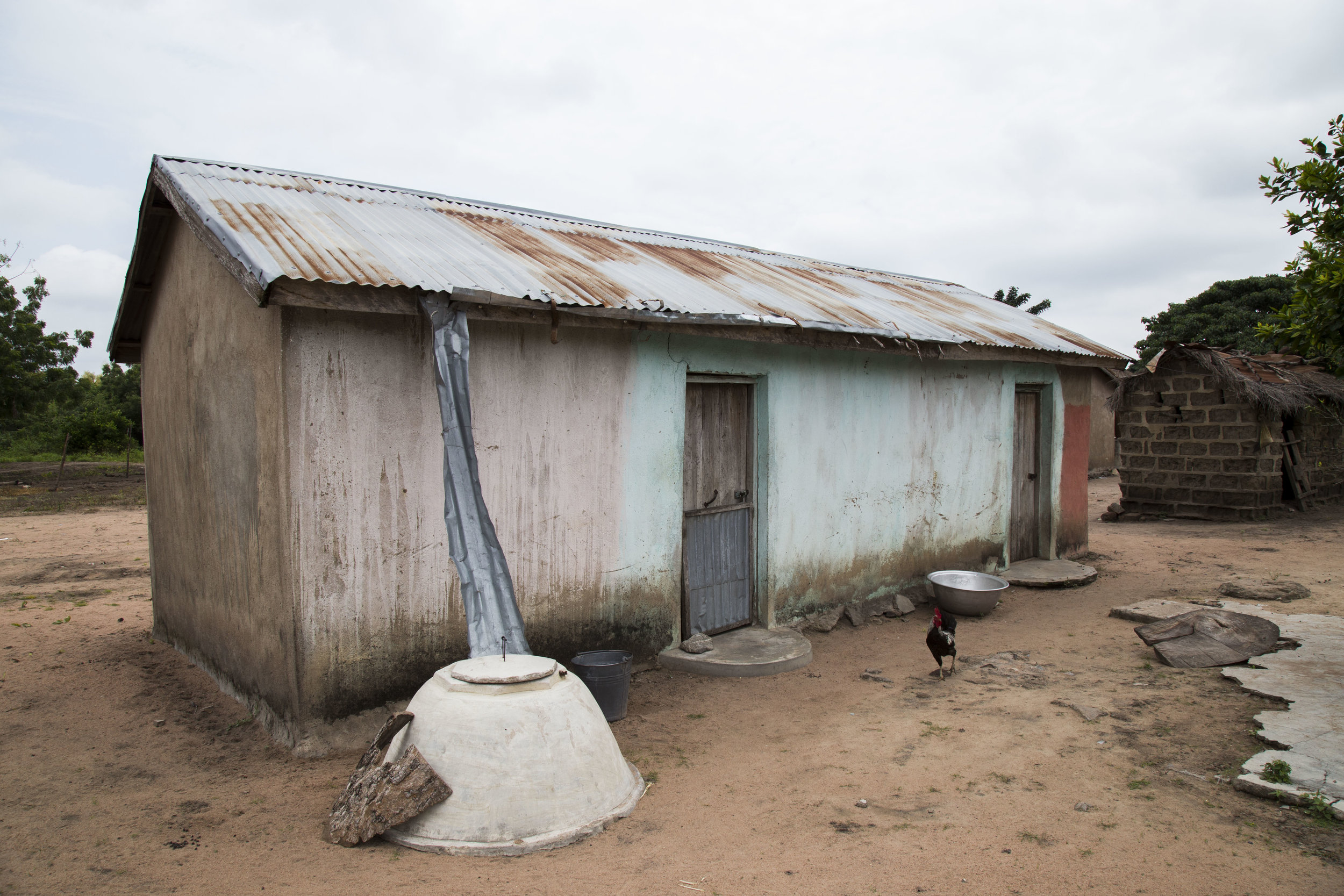 This image shows a rain water collection system in a village