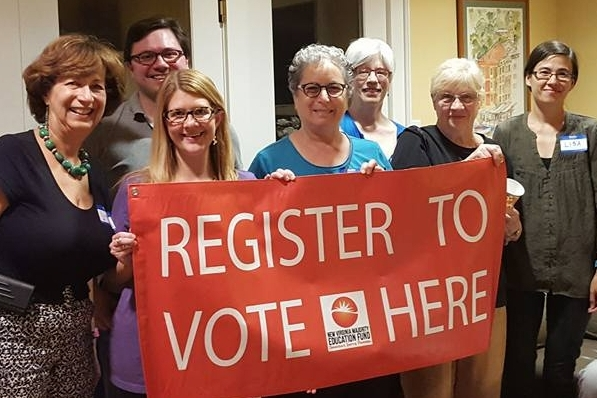 WDC members & friends joining efforts with other groups to register voters.