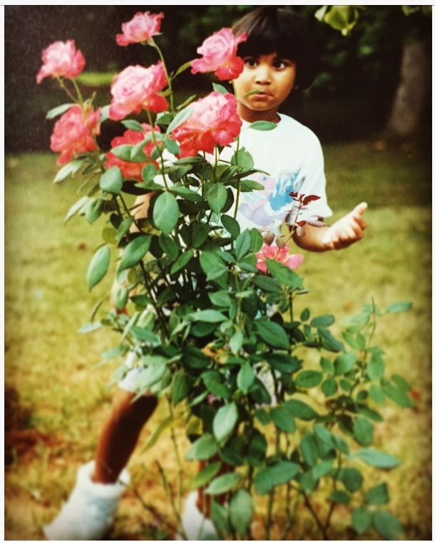 I was upset that the rose bush was taller than me...not much has changed :)