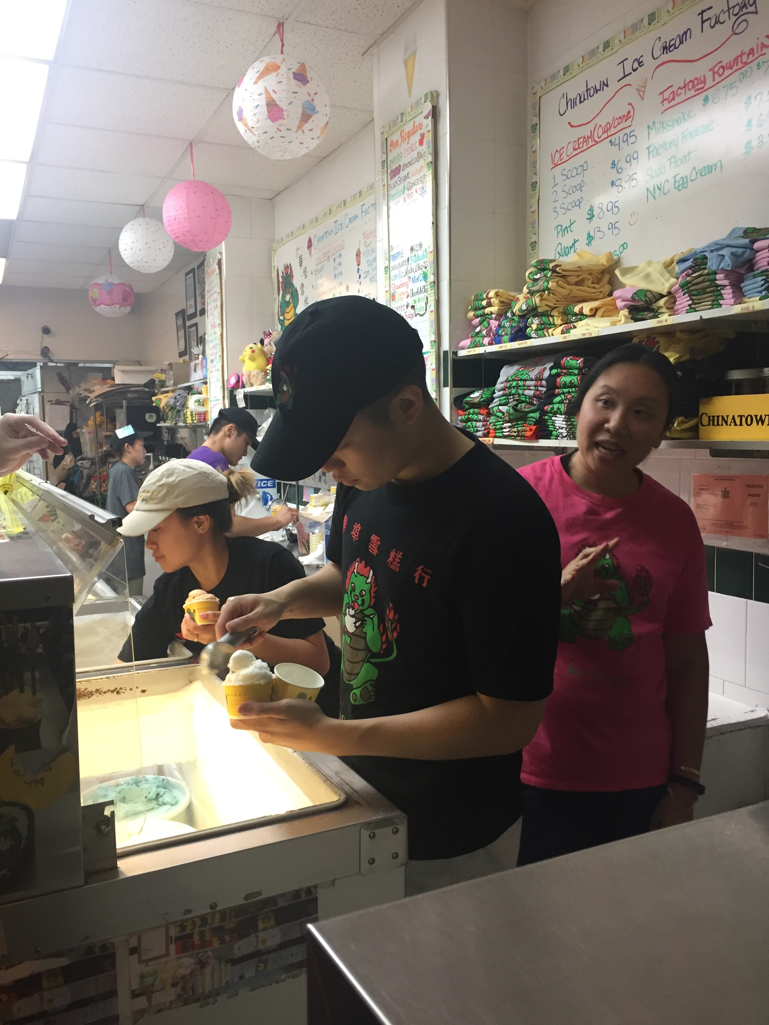 The  helpful employees at The Original Chinatown Ice Cream Factory working hard to help us find the perfect flavors for our picky palettes.