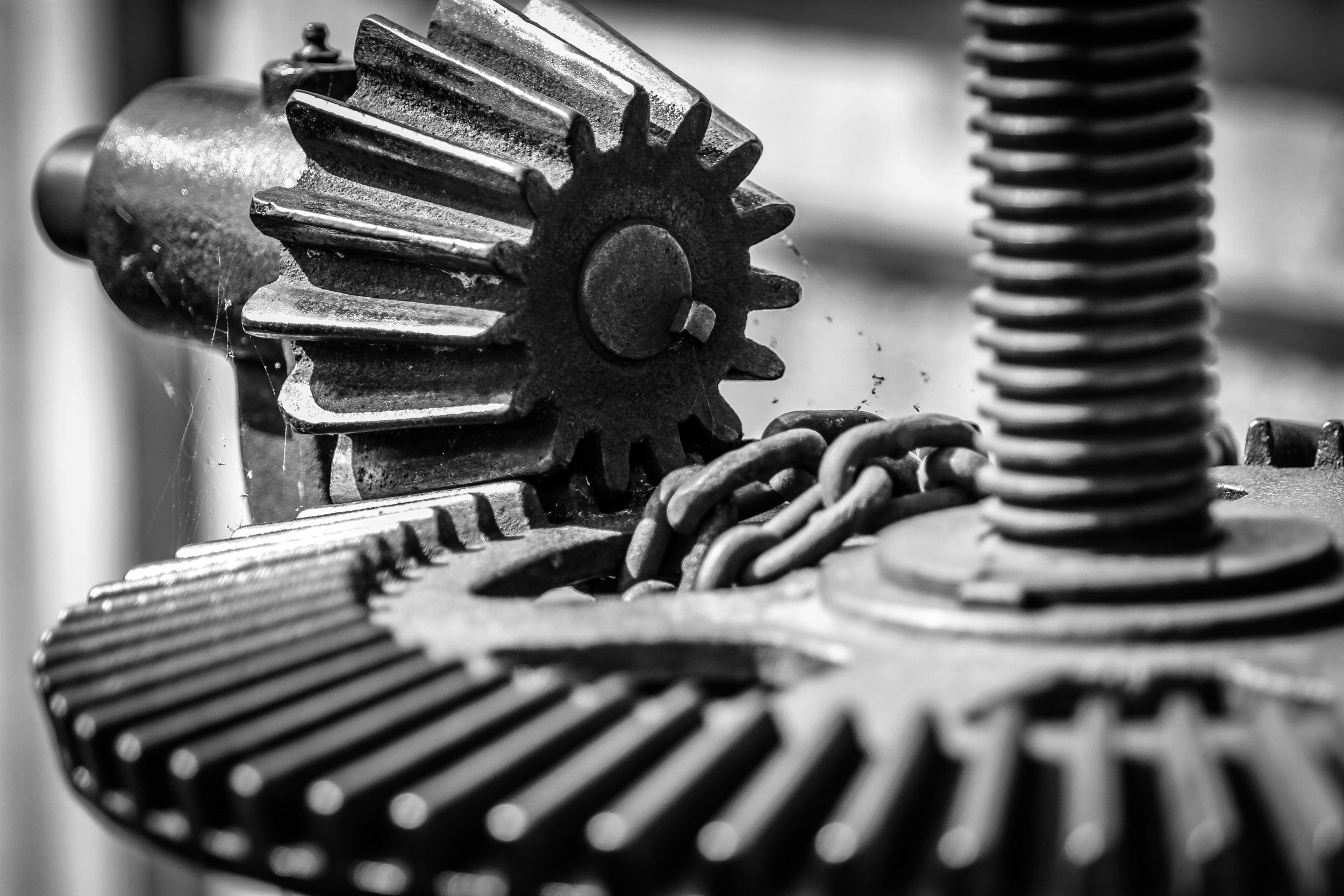 Old close up photo of gears and chain