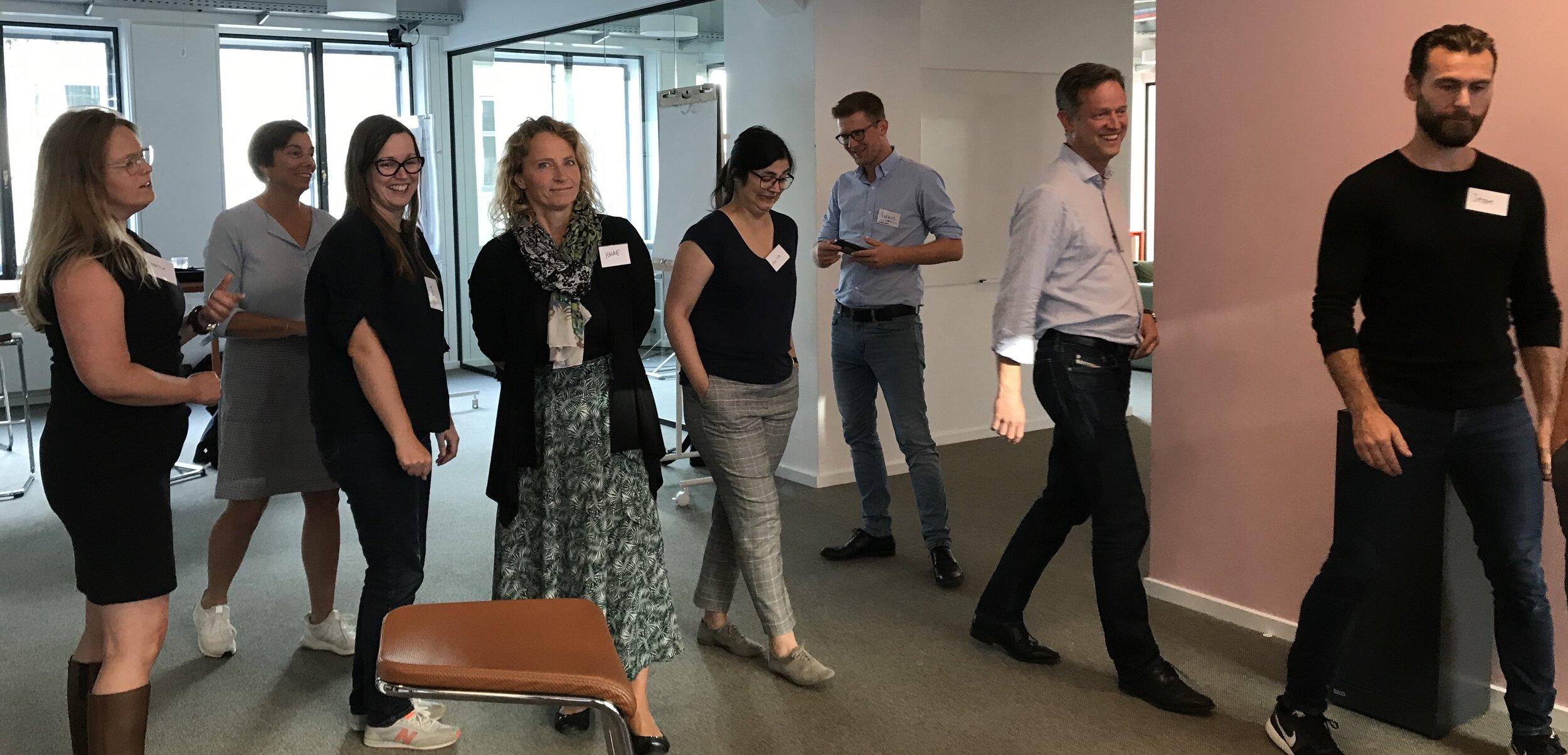 Participants walking in an office space in Copenhagen.