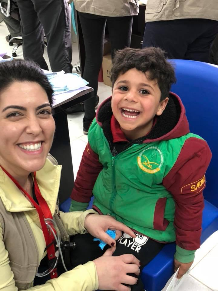 Dr. Lattouf with patient at Syrian Refugee Camp January 2018. This kid had 0 cavities!