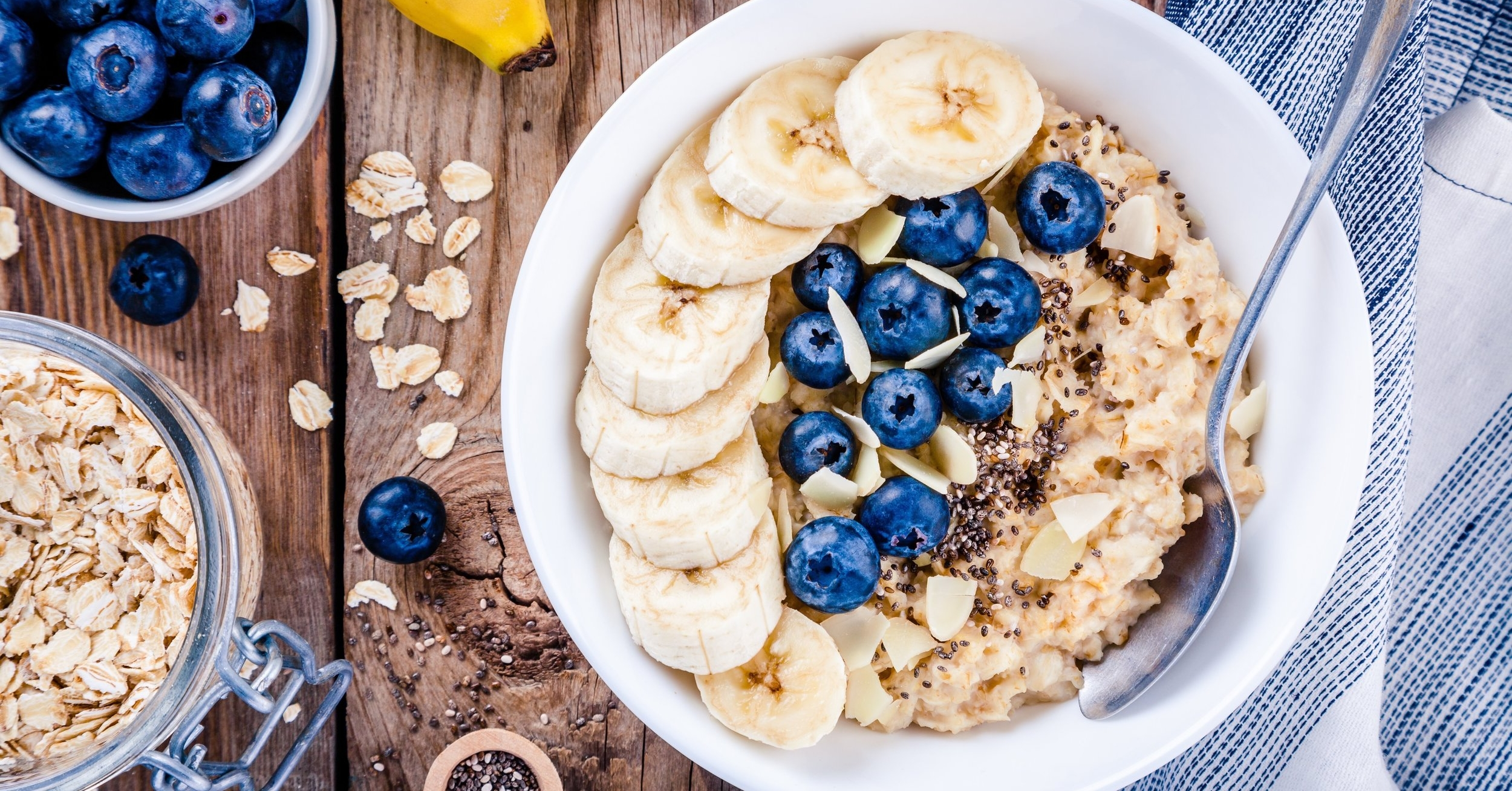 Plant-based breakfast oatmeal, healthy fats, nuts, almonds, berries, granola and vegan brunch ideas.