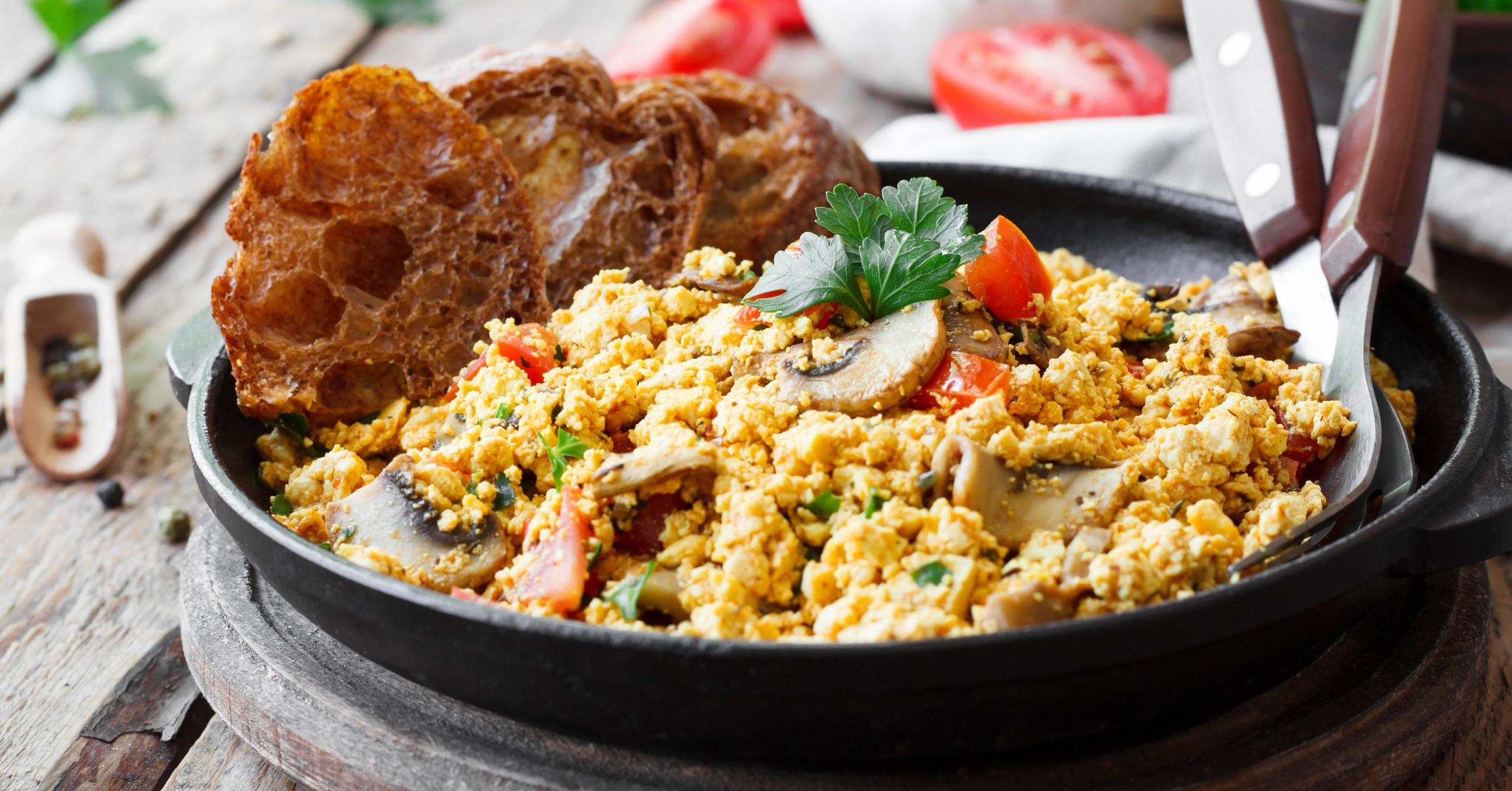 Plant-based breakfast tofu scramble, vegetables and vegan brunch ideas.